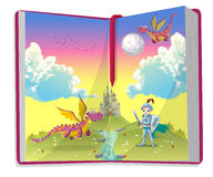 Open book about young knight and two dragons Royalty Free Stock Photo