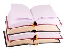 Open books. Pile of open books against white Stock Images