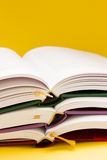Open books. Pile of open books on orange background royalty free stock photography