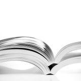Open books. On white table Stock Photos