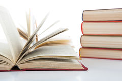 Open Books And Stack Of Books On White Stock Image