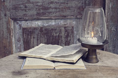 Open books and candlestick. On a vintage wooden table Royalty Free Stock Images