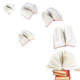 Open books fly out of stack Stock Image