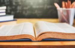 Open books with formulas on the chalkboard .education concept Royalty Free Stock Images