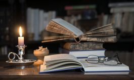 Open books with glasses Stock Photo