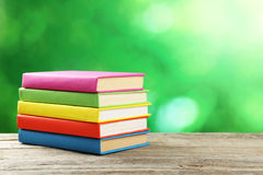 Open books on grey wooden background. Royalty Free Stock Photography