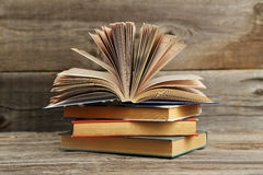 Open books on grey wooden background. Royalty Free Stock Image
