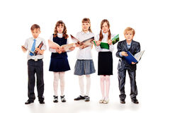Open books. Group of cheerful children standing with books. Isolated over white royalty free stock images