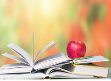 Open books red apple school education background. Royalty Free Stock Image