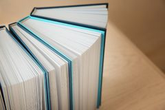 Open books in row on wooden table. Closeup Royalty Free Stock Images