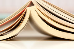 Open books on a table Stock Images