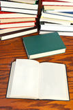 Open books on wooden table Royalty Free Stock Images