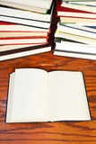 Open books on wooden table Stock Image
