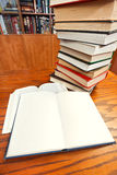 Open books on wooden table Stock Photos