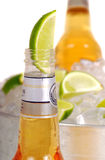 Open bottle of beer with lime Royalty Free Stock Photography