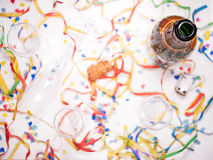 Open bottle of champagne. An open bottle of champagne with confetti Royalty Free Stock Photography