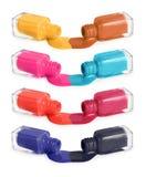 Open bottles with bright nail polish Stock Photos