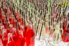 Open Bottles of Sodas with Drinking Straws Royalty Free Stock Image