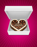 Open box with chocolate cake in heart form Stock Photo
