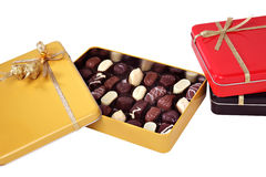 Open box of chocolates. Closeup of open box of chocolates, isolated on white background Stock Image