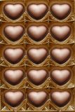 Open box of chocolates. Open box of chocolate hearts Stock Photos