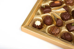 Open box with chocolates. On white background Royalty Free Stock Photo