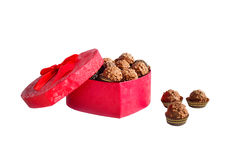 An open box of chocolates. Red open box in the form of heart with chocolates Stock Photos
