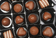 Open box of chocolates. In tray Royalty Free Stock Photography