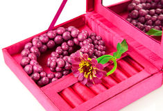 Open box with decoration and flower. Open pink box with decoration and flower on white background Stock Images