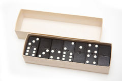 Open box of dominoes Royalty Free Stock Image