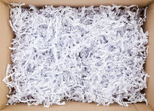 Open Box with Filling Material Stock Photo