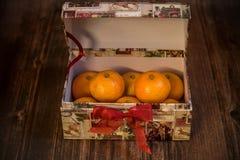 Open box full of ripe juicy tangerines, Christmas fruits stock image