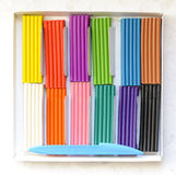 Open box with new set of multi-colored plasticine. Stock Image