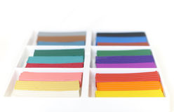 Open box with new set of multi-colored plasticine. Stock Photos