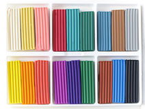 Open box with new set of multi-colored plasticine. Stock Photo