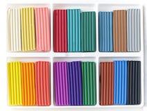 Open box with new set of multi-colored plasticine. Stock Photo