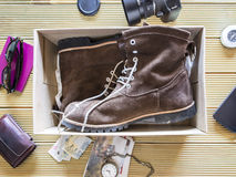Open box with a pair of boots. Preparing an adventure trip. Royalty Free Stock Image