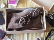 Open box with a pair of boots. Preparing an adventure trip. Stock Photo