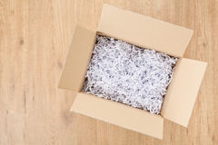 Open Box or Parcel on the Floor Royalty Free Stock Images