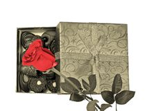 Open box with pralines and on top a red rose. Open box with delicious pralines and on top a beautiful red rose for your valentine Stock Photos