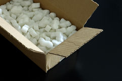 Open box with protection peanuts. Open cardboard box with packing styrofoam peanuts inside stock images