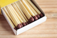 Open box of safety matches. On a wooden surface Royalty Free Stock Photos