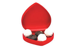 Open box in shape heart with candy Stock Photos