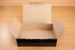 Open box on wood background Royalty Free Stock Photography