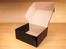 Open box on wood background Royalty Free Stock Images