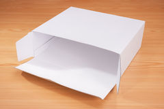Open box on wood background Stock Images