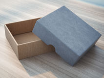 Open box on wooden table Royalty Free Stock Images