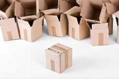 Open boxes behind one sealed box infront Royalty Free Stock Images