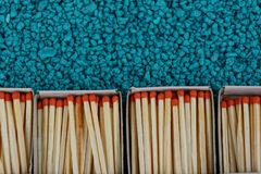 Open boxes with matches on a blue stone background stock photo