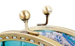 Open brass clutches of retro stile handbag Royalty Free Stock Photography